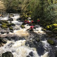 Water team searching a fast river