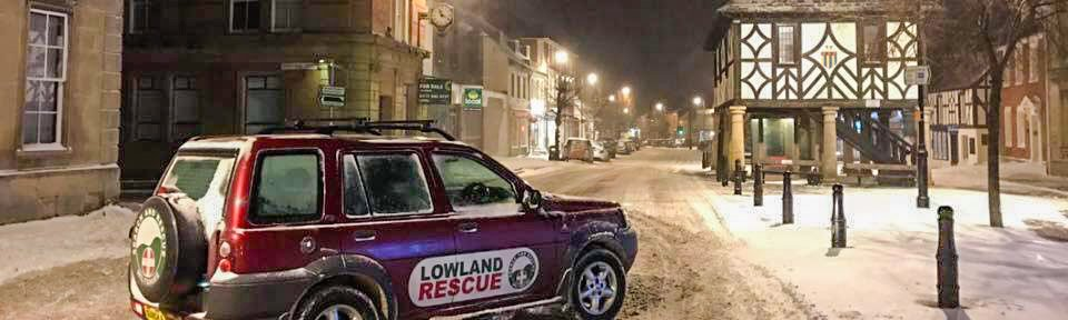 4x4 vehicle in a snowy town centre
